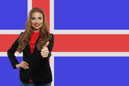 Iceland concept with cute happy woman against the Icelandic flag