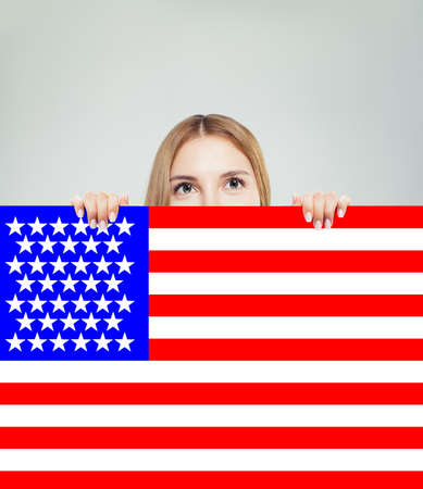 Portrait of happy american girl with USA flag