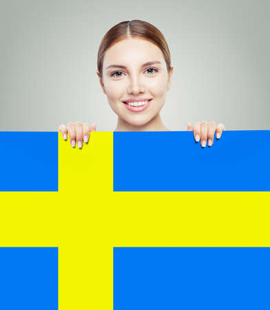 Sweden. Happy student girl and Sweden flag Stockfoto