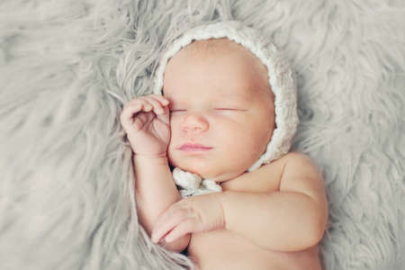 Portrait of pretty newborn. Cute baby sleeping and smiling Stock Photo