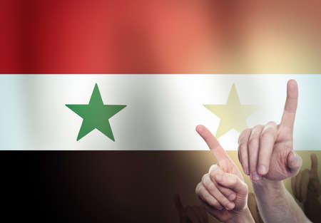 Two hands shackled a metal chain on the   of the Syria flag. Freedom concept