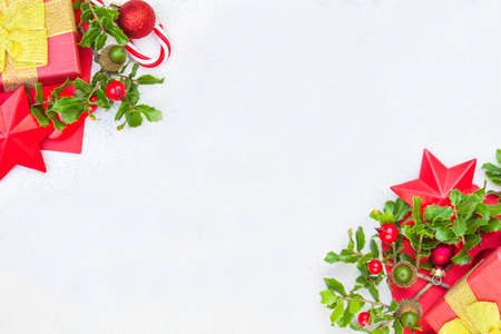 Christmas background with holly berries and decorations corner Stok Fotoğraf