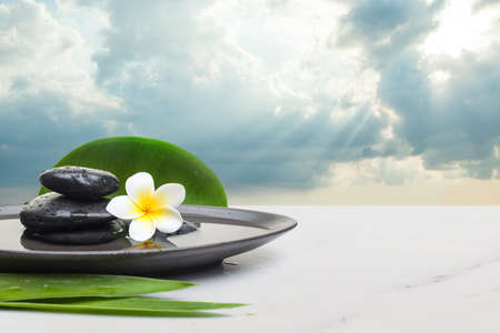 spa objects with big leaves on white background. Spa healthy concept with clouds sky and sunlight.