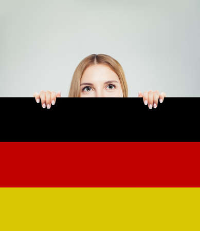 Travel in Germany concept. Pretty woman showing Germany flag