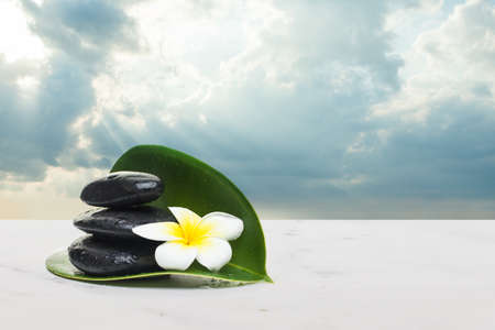 spa tropical objects for healthy therapy on white background. Spa healthy concept with clouds sky and sunlight.