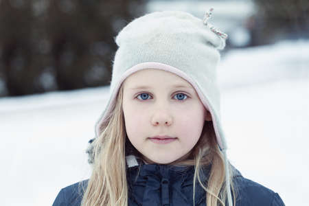 Cute child girl in winter day outdoors, lifestyle portrait