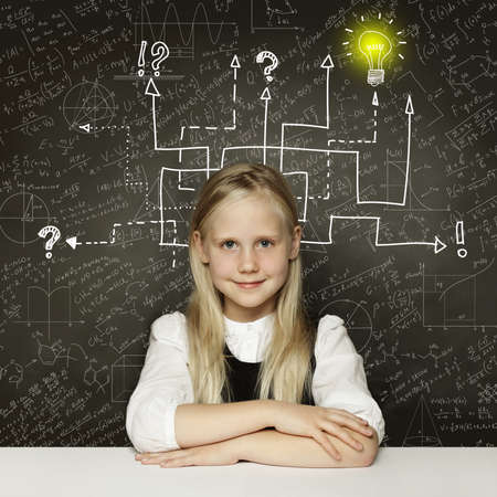 Thinking child girl with question signs and light idea bulb, education concept 写真素材