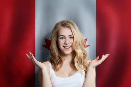 Canadian concept with happy Surprised cute girl with Canada Фото со стока