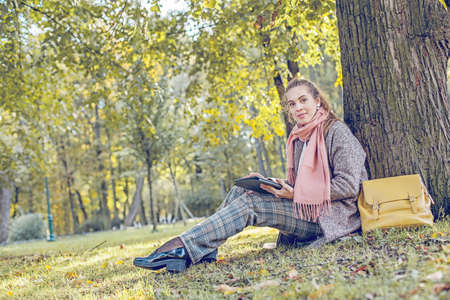 Businesswoman sitting on grass, working with tablet laptop and relaxing Reklamní fotografie