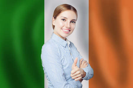 Love Irish concept. Happy cute woman with Irish flag 版權商用圖片