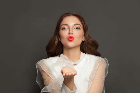 Beautiful woman blowing kiss