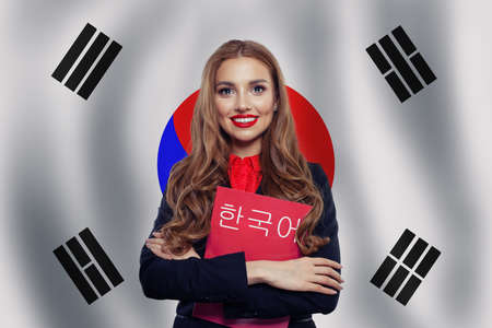 Study korean language. Happy cheerful woman student on the Republic of Korea flag