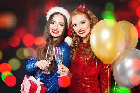 Winter fashion girls on abstract bokeh glitter sparkle party Фото со стока