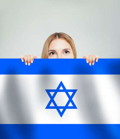 Beautiful happy young woman with Israel flag 版權商用圖片