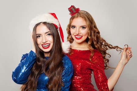 Two women in Santa hat portrait Фото со стока
