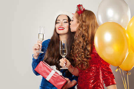 Portrait of young women with Christmas present boxes