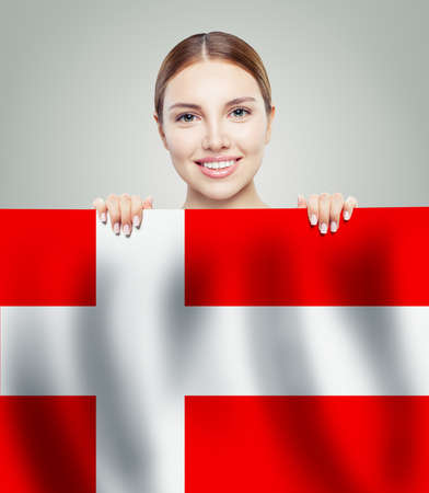Smiling woman student showing Denmark flag