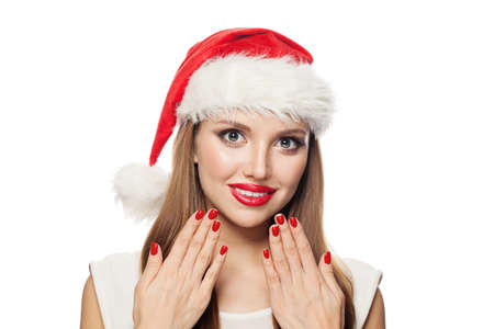 Happy Christmas woman Santa with red manicured nails isolated on white background. Christmas and New Year portrait Фото со стока