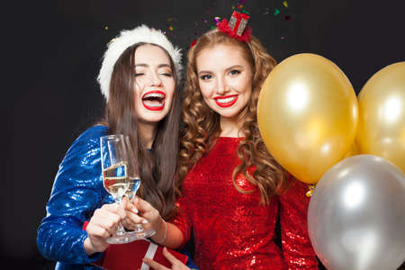 Winter girls in party dress celebrating Merry Christmas and Happy New Years concept