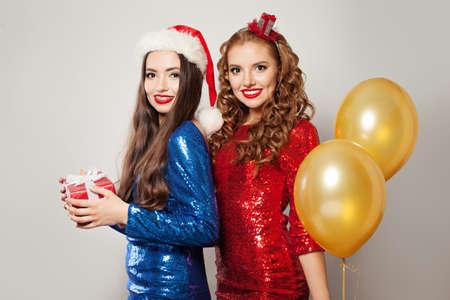 Portrait of two happy Christmas women Фото со стока