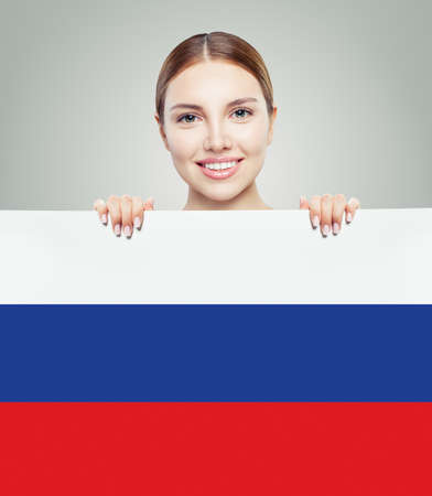 Russia concept with happy woman student with the Russian Federation flag background.