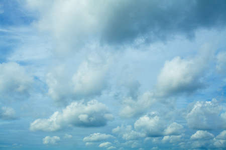 Fluffy Clouds In Blue Sky. Background From Clouds. Stock Photo
