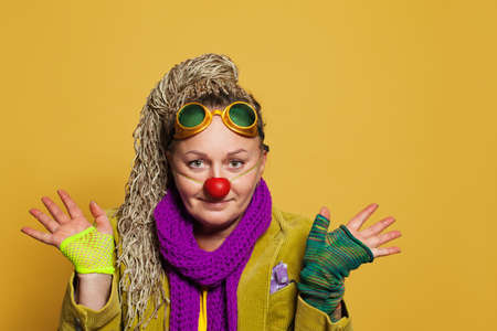 Smiling woman psychologist in clown costume for performance in childrens hospis. Real people portrait