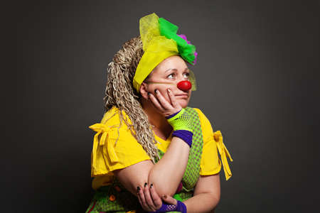Woman clown dreaming portrait. Performance Actress at work Stockfoto