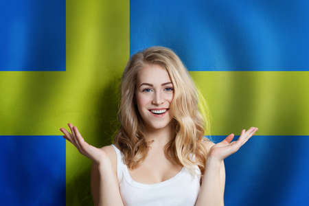 Surprised cute happy girl with Sweden flag background. Travel and education concept Stock fotó - 138168155