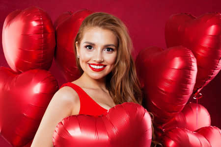 Perfect model girl with red balloons, Valentine's day concept Banco de Imagens
