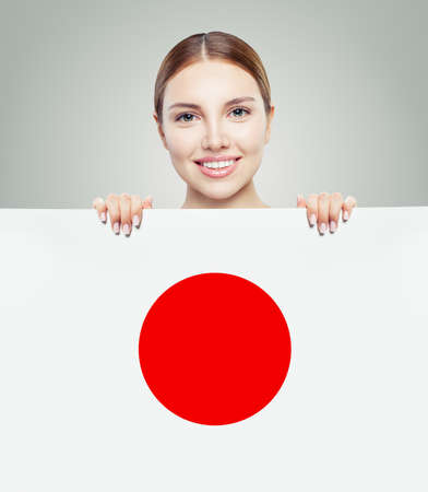 Love Japan concept. Young woman with japanese flag background. Travel, work, education and internship in Japan
