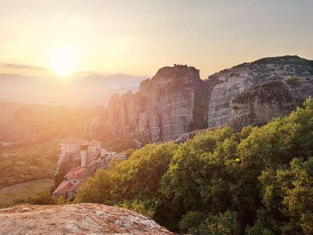 Monasteries on the rocks and beautiful sunset, Meteora, Greece. Stock Photo