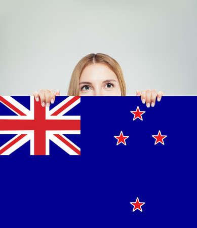 Travel in New Zealand. Happy girl student with New Zealand flag