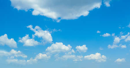 Fluffy Clouds In Blue Sky. Background From Clouds. Banco de Imagens