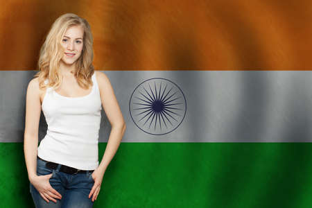 India concept. Happy blonde woman with the India flag background. Travel and learn hindi language Foto de archivo