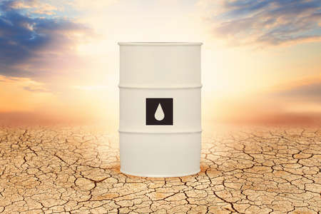 One white oil barrel against sky clouds
