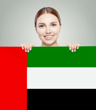 Happy woman student with the UAE flag background. United Arab Emirates, travel and learn arabic language concept 版權商用圖片 - 147683567