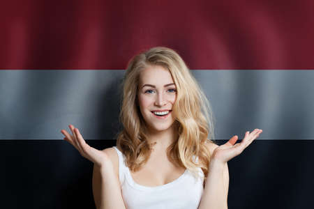 Happy Blonde woman student on the Egypt flag background. Egypt, travel and learn arabic language concept