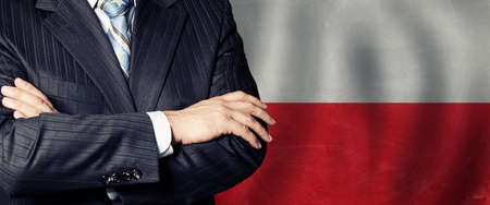 Male hands against Polish flag background, business, politics and education in Poland concept