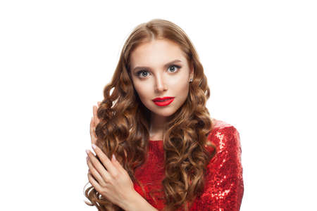 Perfect redhead woman with ginger curly hairstyle and red lips makeup isolated on white background Banco de Imagens