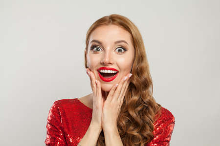 Happy exsited redhead woman with ginger hair and red lips makeup on white background