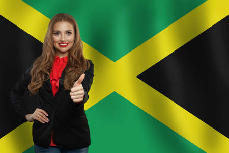 Travel and study in Jamaica concept with Pretty girl student against Jamaica flag background