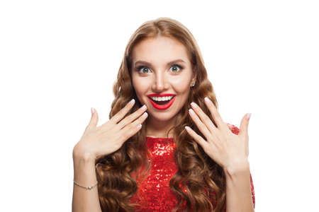 Beautiful surprised woman model showing hand with manicured nails isolated