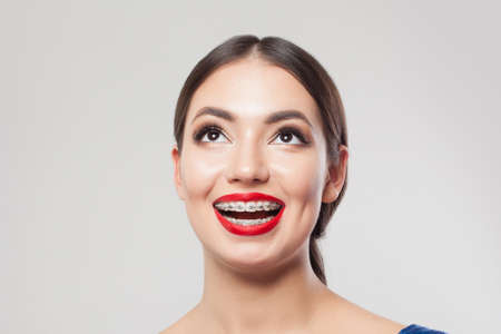 Exsited woman with braces on teeth, close up portrait Banco de Imagens