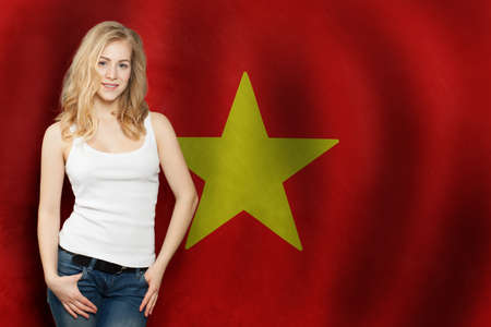 Cute blonde girl with Vietnam flag background. Travel or Business Concept 版權商用圖片
