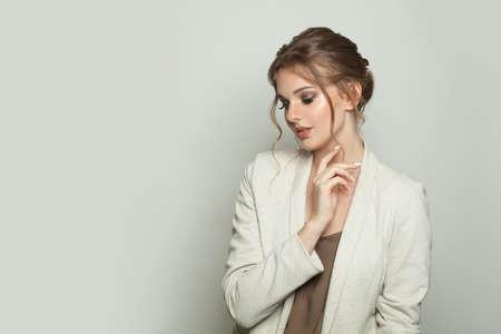 Fashion woman wearing white linen blazer on white background