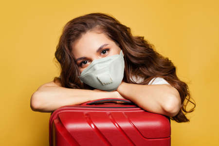 Woman traveler tourist passenger in protective medical mask. Travel, weekends and holidays with Covid-19 pandemic concept