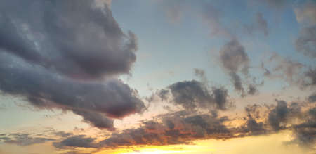 Sunset panorama. Nightly sky with clouds and sun stream Standard-Bild