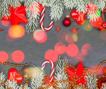 Christmas border with garland and colorful bokeh on black background Standard-Bild