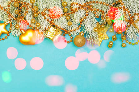 Golden Christmas decorations on bright blue background with bokeh light
